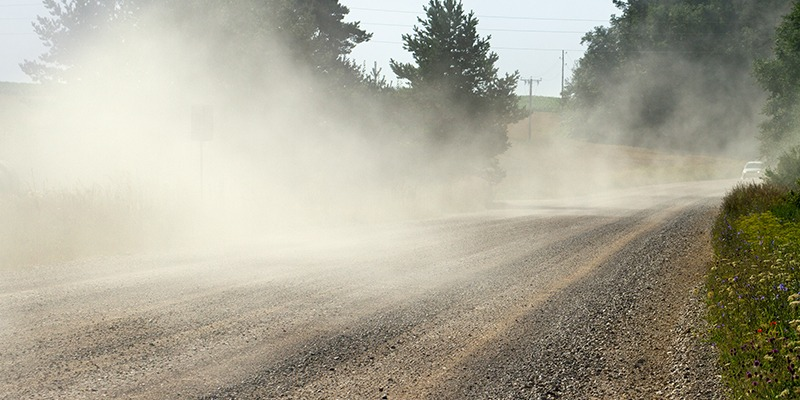 dust being released into the air on a dirt road